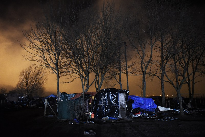 Tents in 'The Jungle' the camp where hundreds of migrants are living in Calais, France from where they try to cross the English Channel in order to make it to the United Kingdom, pictured on 25th February 2015. Photograph by Mary Turner.