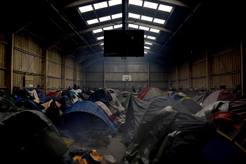 Tents inside a warehouse in 'The Jungle' the camp where hundreds of migrants are living in Calais, France from where they try to cross the English Channel in order to make it to the United Kingdom, pictured on 25th February 2015. Photograph by Mary Turner